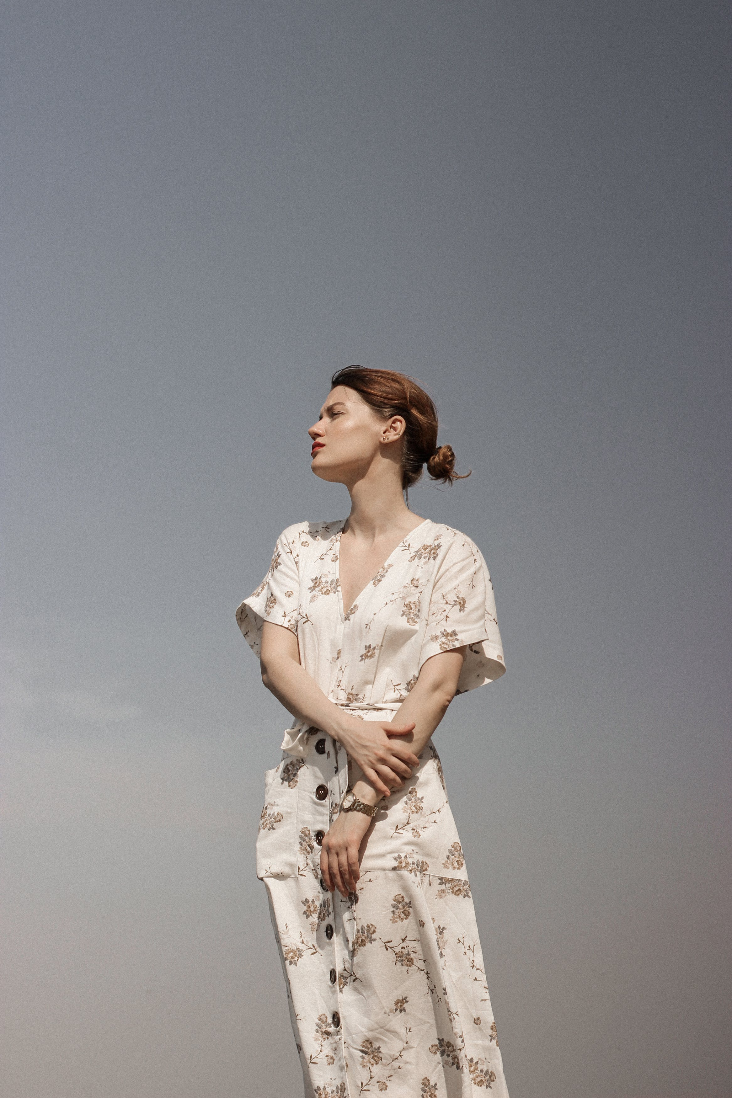 Woman in White and Brown Floral Dress